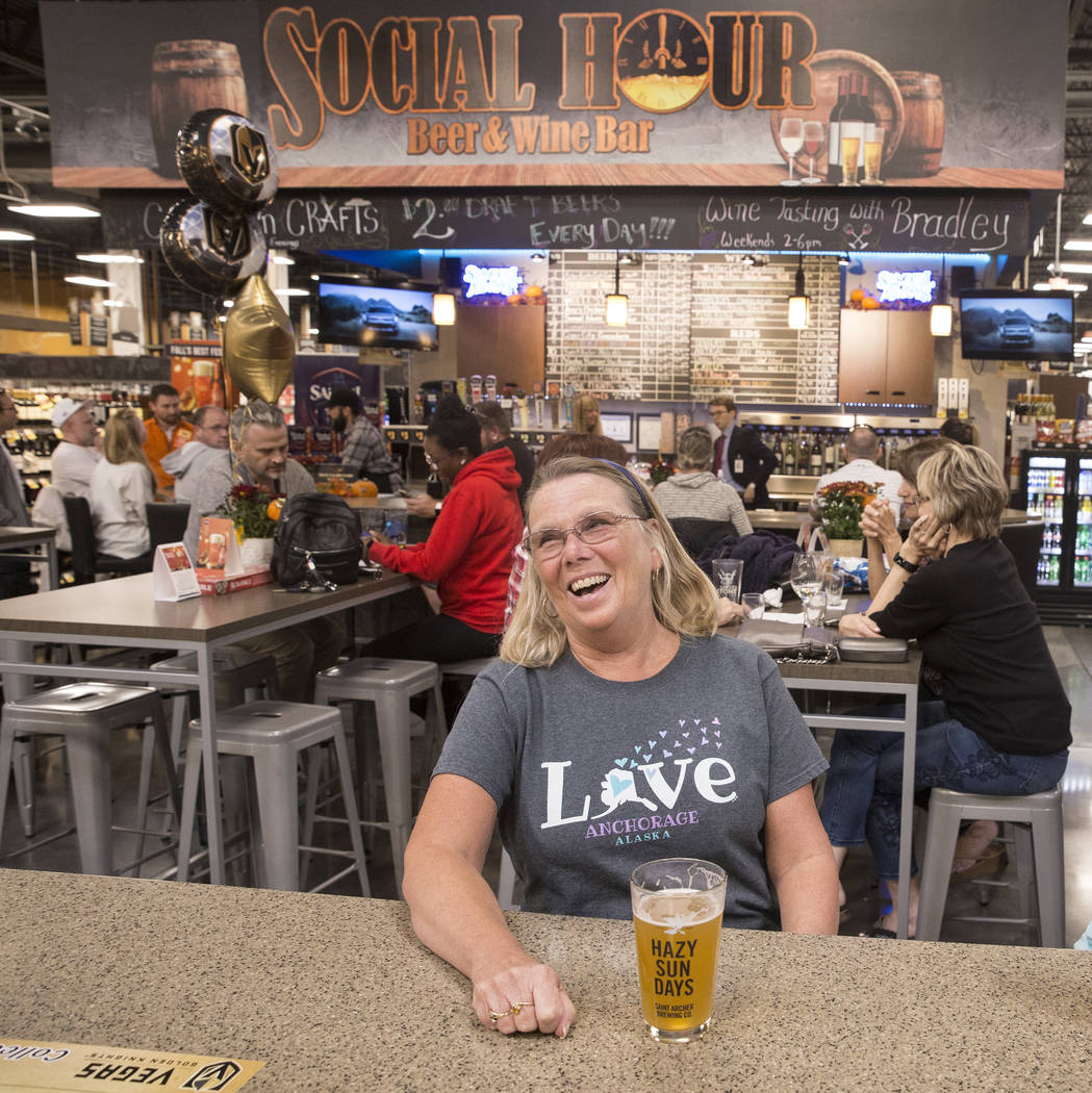 Deb Crowl, from Anchorage, AK., shares a laugh with husband Ron (out of frame) at Social Hour B ...