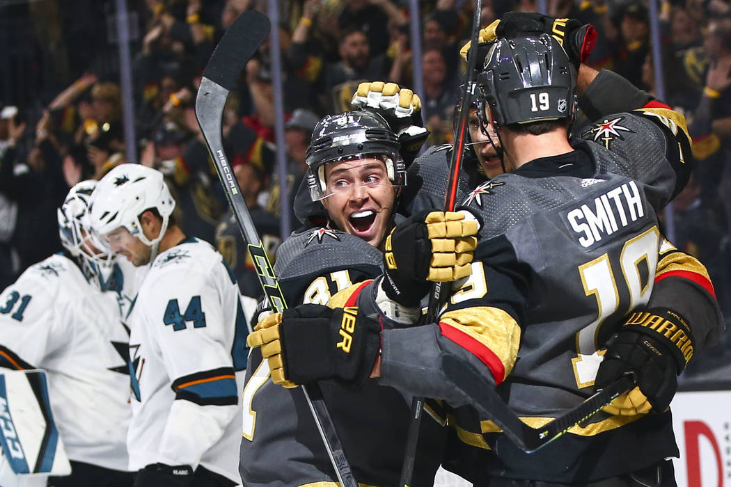 Golden Knights' Jonathan Marchessault, left, celebrates a goal by Reilly Smith (19) during the ...