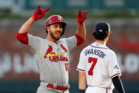 St. Louis Cardinals' Paul DeJong celebrates after hitting a double to score a run in the second ...