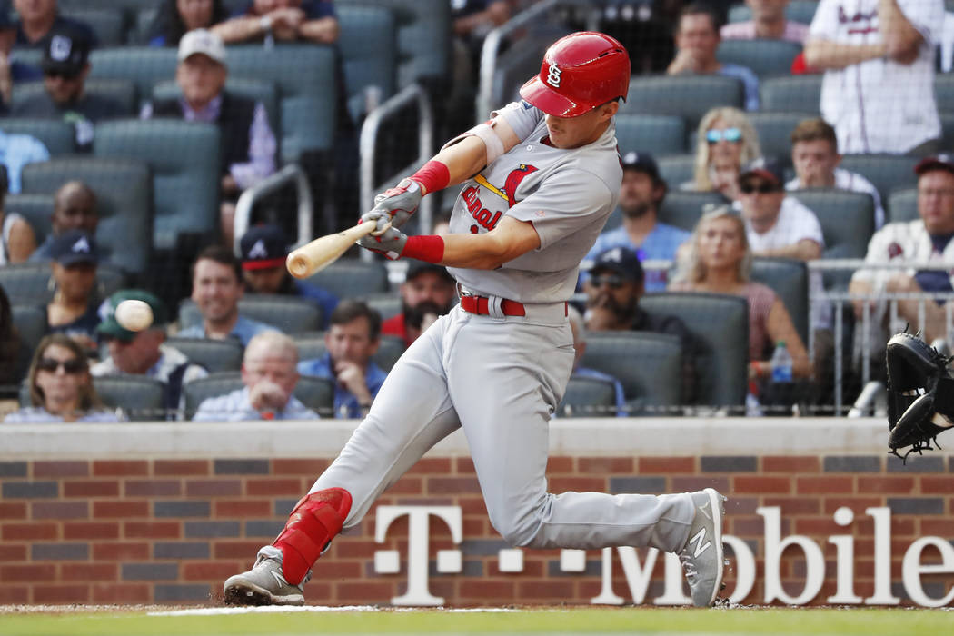 St. Louis Cardinals' Tommy Edman doubles to score teammates Marcell Ozuna and Yadier Molina dur ...