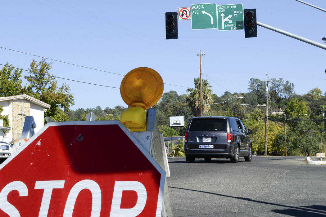 A stop sign is placed at an Oroville Dam Boulevard intersection with no power Wednesday, Oct. 9 ...