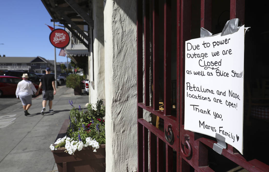 A sign at Mary's Pizza Shack informs customers of their closure due to a PG&E power shutdow ...