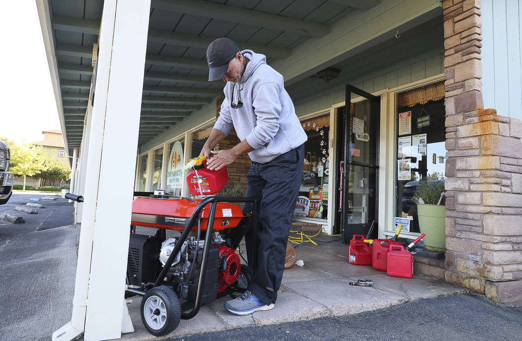 Cliff Dunn, owner of Pawsarotti's pet store, runs a generator in order to keep a freezer full o ...