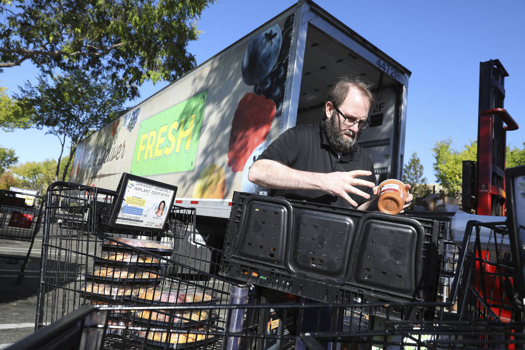Jamie Olivas transfers items from a Safeway store on Calistoga Road into a refrigerated trailer ...