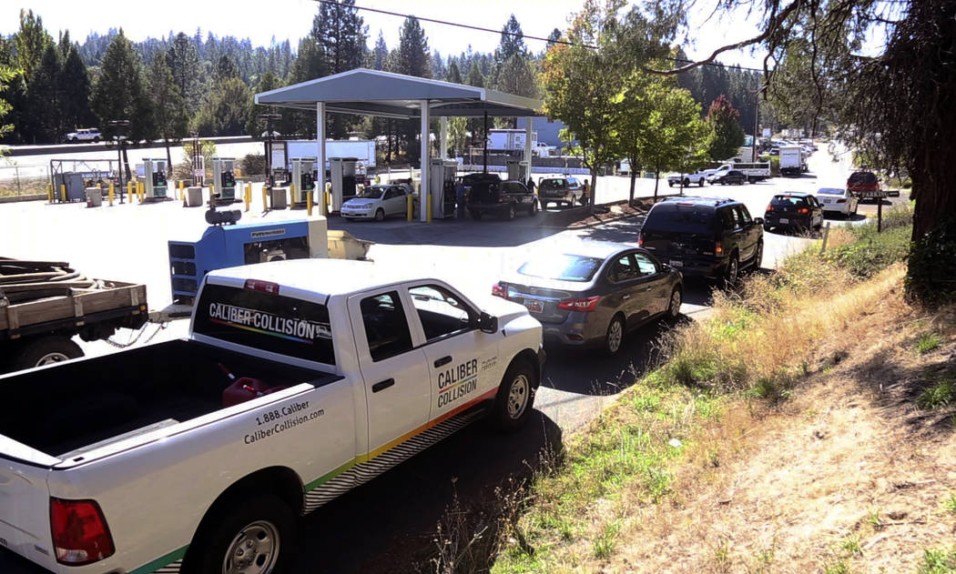 The line for gas stretches around to Nevada City Highway from the Robinson gas station in Nevad ...