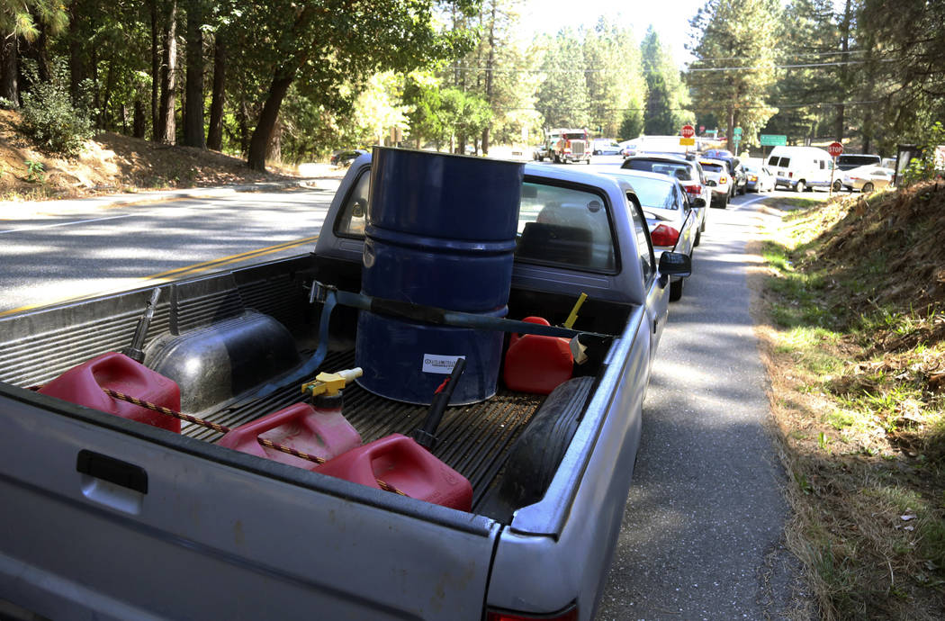 People wait in line for gas at Robinson Enterprises in Nevada City, Calif., Wednesday, Oct. 9, ...
