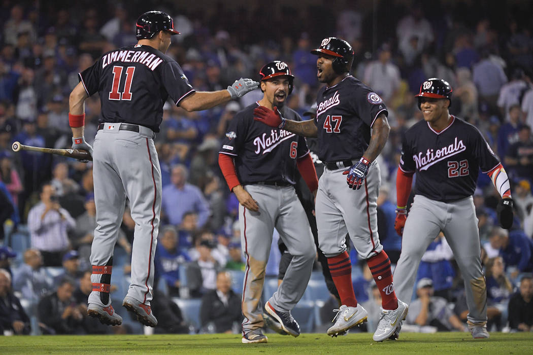 Washington Nationals' Howie Kendrick (47) celebrates after a grand slam against the Los Angeles ...