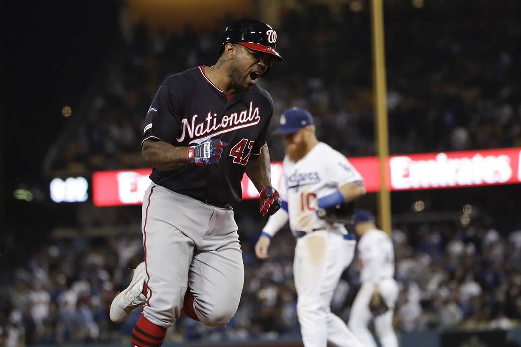 Washington Nationals' Howie Kendrick celebrates after a grand slam against the Los Angeles Dodg ...