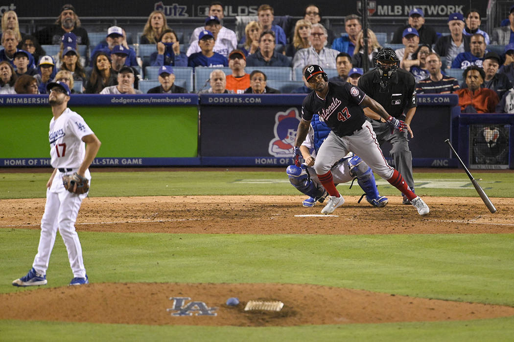 Washington Nationals' Howie Kendrick (47) watches his grand slam off Los Angeles Dodgers relief ...