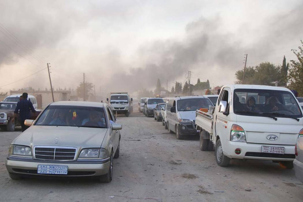Syrians flee shelling by Turkish forces in Ras al Ayn, northeast Syria, Wednesday, Oct. 9, 2019 ...