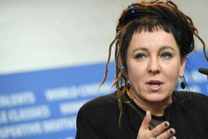 In a Feb. 12, 2017, photo Polish author Olga Tokarczuk spekas during a press conference in Berl ...