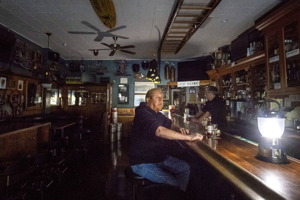 Joseph Pokorski drinks a beer at The Town Square as downtown Sonoma, Calif., remains without po ...