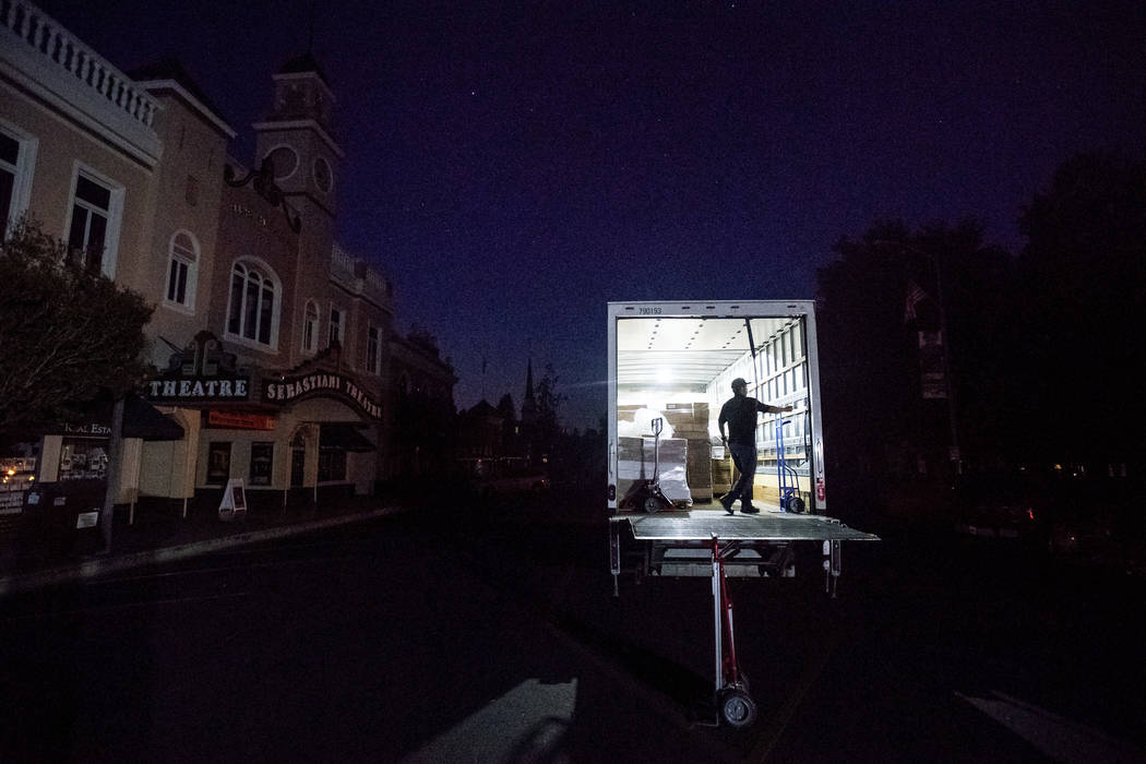 Armando Espinoza delivers paper products to a cafe in downtown Sonoma, Calif., where power is t ...