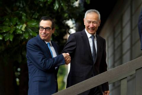 Chinese Vice Premier Liu He shake hands with Treasury Secretary Steven Mnuchin, as he arrives f ...