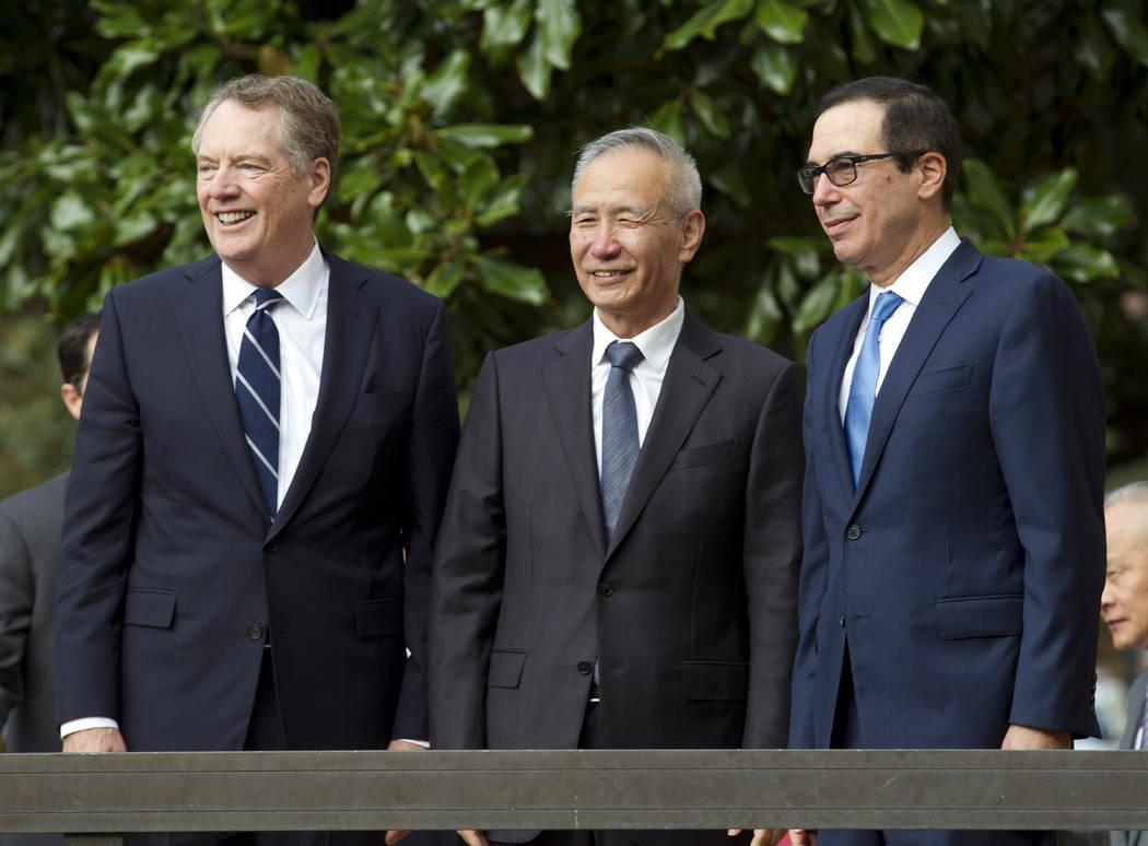 Chinese Vice Premier Liu He accompanied by U.S. Trade Representative Robert Lighthizer, left, a ...