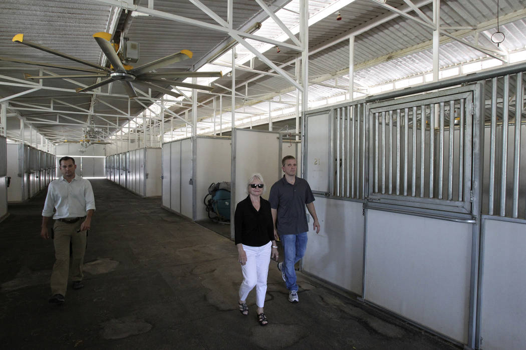Wayne Newton's former stables are shown in a Aug. 27, 2013. From left is project manager John M ...