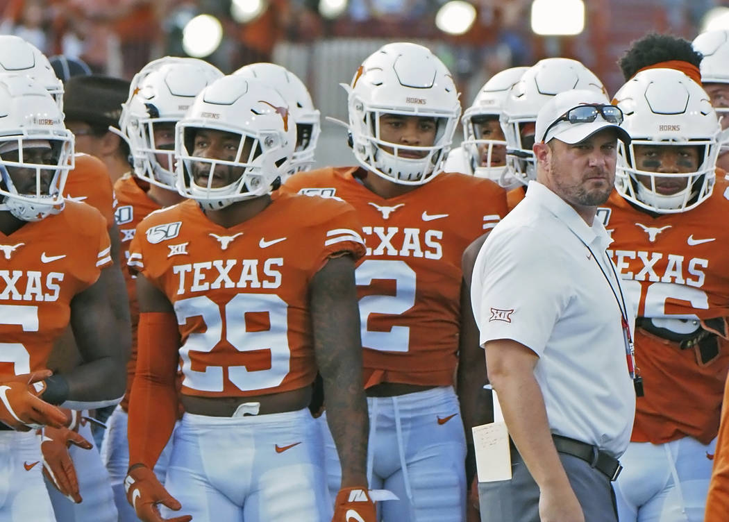 Texas head coach Tom Herman waits with his team before the start of an NCAA college football ga ...