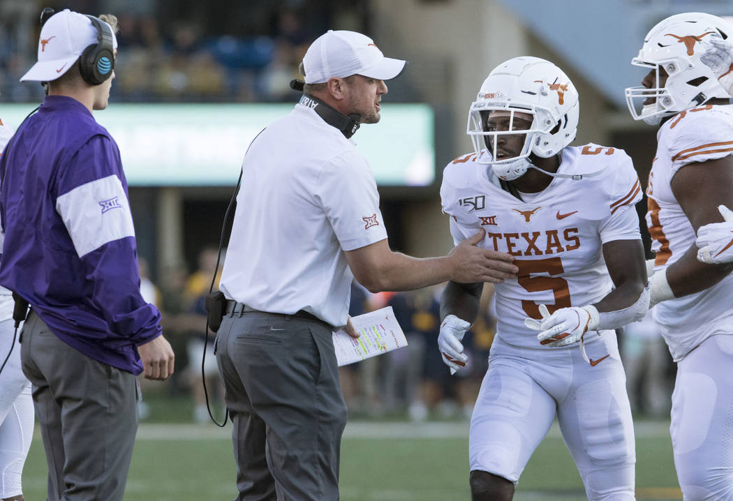 Texas head coach Tom Herman talks to defensive back D'Shawn Jamison (5) during the second half ...