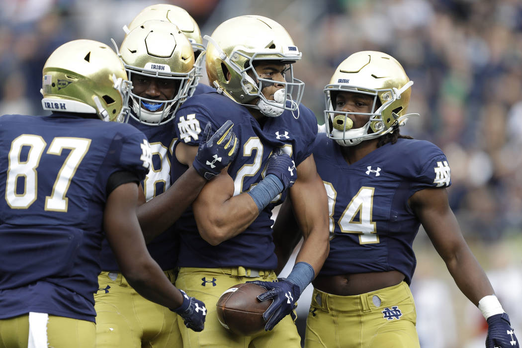 Notre Dame tight end Tommy Tremble (24) celebrates after scoring a touchdown during the first h ...