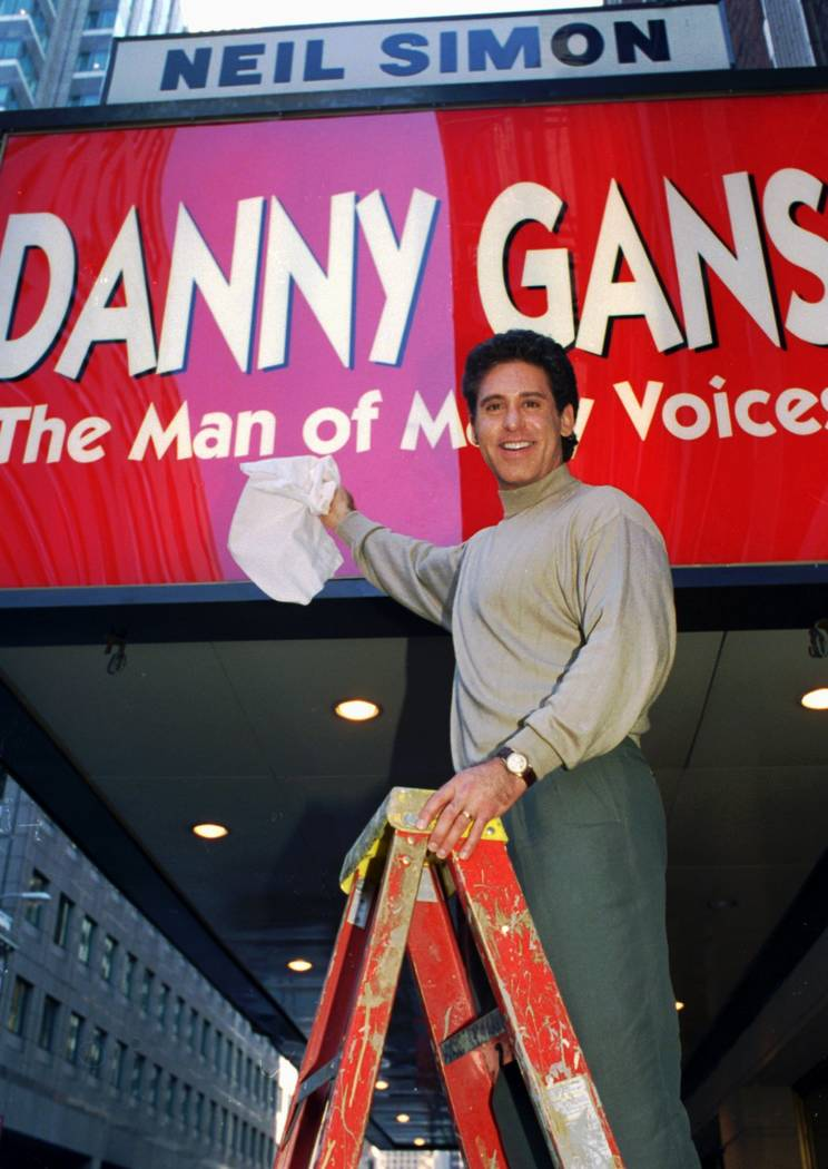 In this Sept. 27, 1995 file photo, Danny Gans dusts off the marquee of New York's Neil Simon T ...