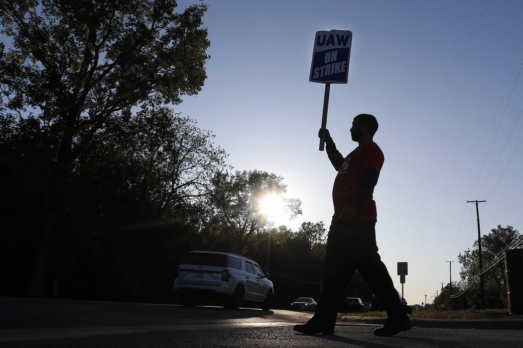 A member of the United Auto Workers walks the picket line at the General Motors Romulus Powertr ...