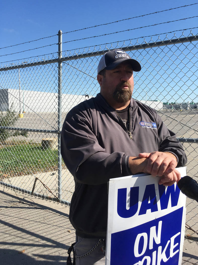 In this Tuesday, Oct. 8, 2019, photo, striking General Motors worker Mike Armentrout stands on ...