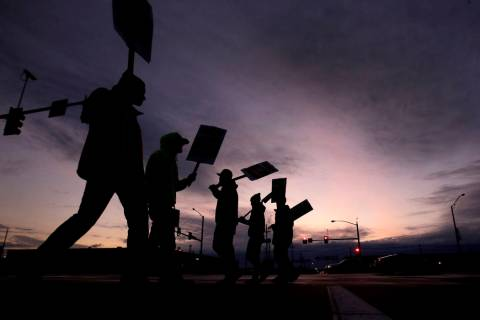 General Motors employees picket outside the Fairfax Assembly Plant in Kansas City, Kan. during ...