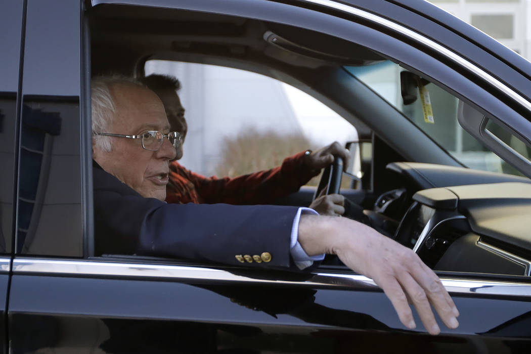 Democratic presidential candidate Sen. Bernie Sanders, I-Vt., departs Burlington International ...