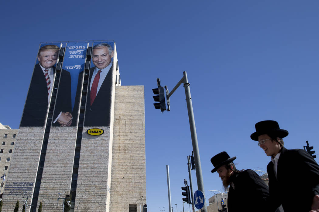 FILE - In this Feb. 4, 2019, file photo, an election campaign billboard shows Israeli Prime Min ...