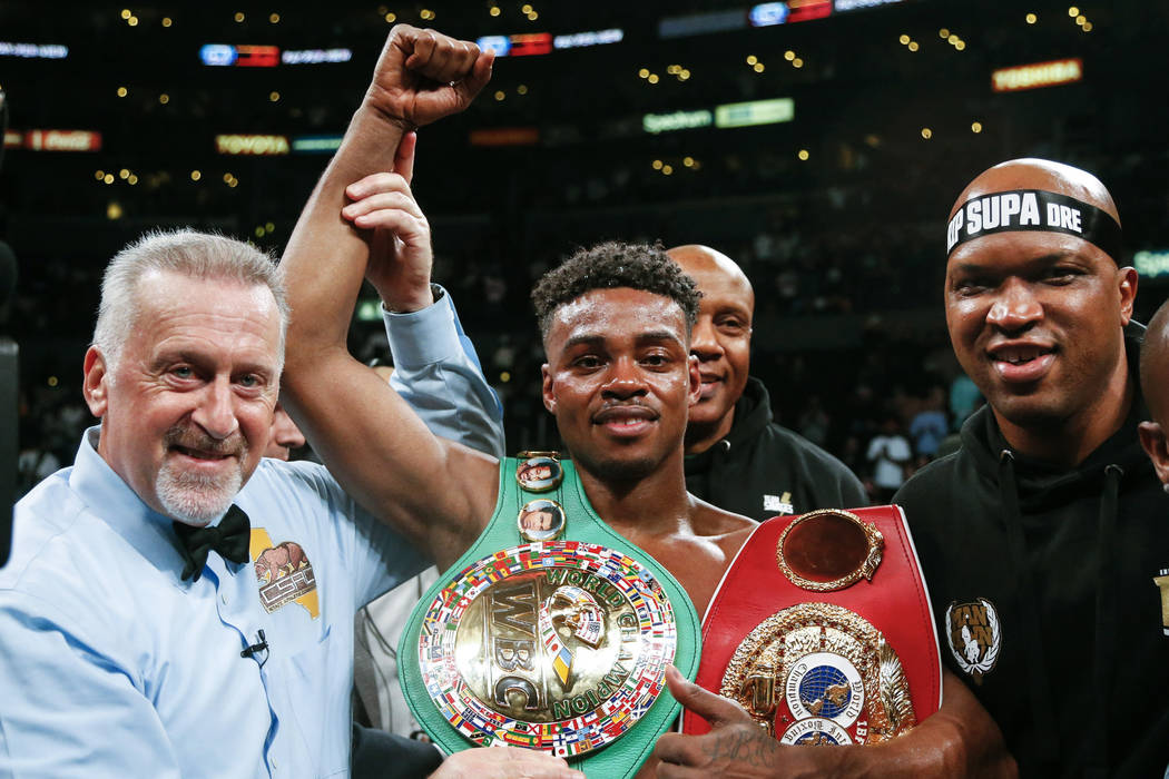 Errol Spence Jr., center, celebrates his victory over Shawn Porter during the WBC & IBF World W ...