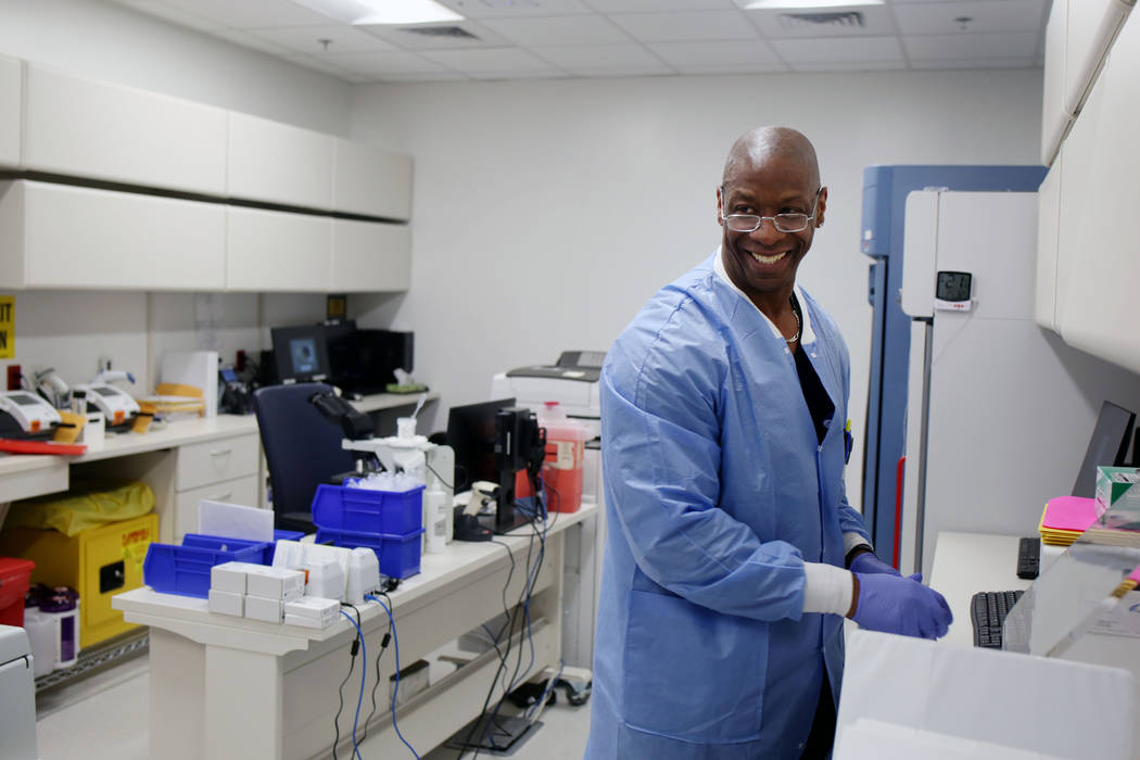 Lead medical tech Vaughn Fredieu works in the on-site laboratory at Valley Health System's new ...