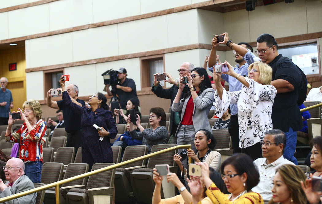 Attendees take photos before the start of the inaugural meeting of the 15-member Asian-American ...