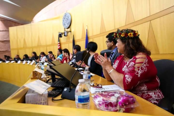 Dorinda Burnet, right, claps during the inaugural meeting of the 15-member Asian-American Pacif ...