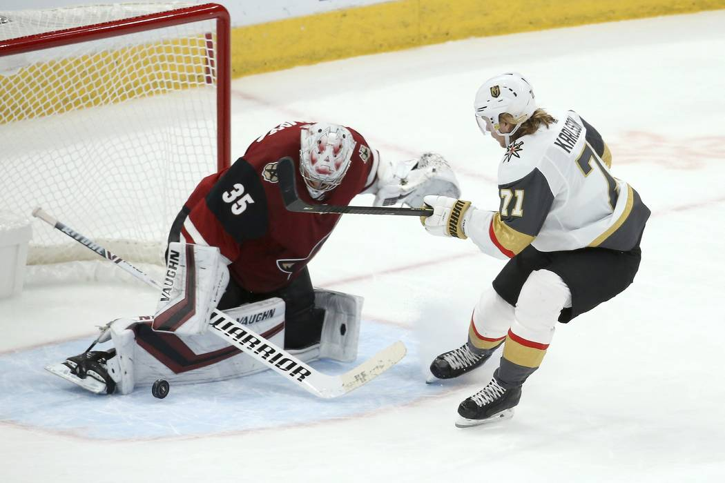 Arizona Coyotes goaltender Darcy Kuemper (35) makes a save on a breakaway shot by Vegas Golden ...