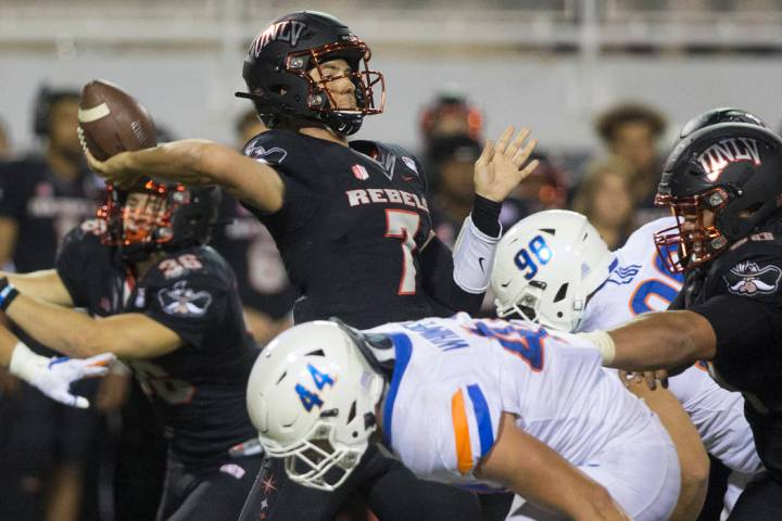 UNLV Rebels quarterback Kenyon Oblad (7) just gets a pass off before the rush from Boise State ...