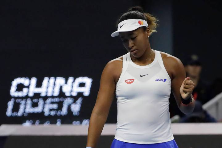 Naomi Osaka of Japan reacts while competing against Ashleigh Barty of Australia during their wo ...