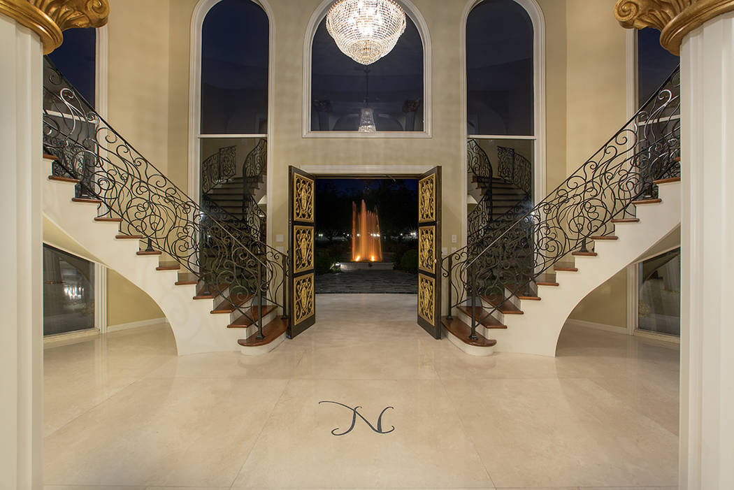 """Wayne Newton's former mansion has Newton's """"N"""" in the grand entry. Texas businessman Lacy Harbe ..."""