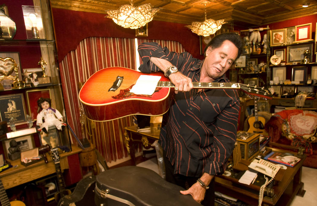 Longtime Las Vegas headliner Wayne Newton holds a guitar, which was a gift from Elvis Presley, ...