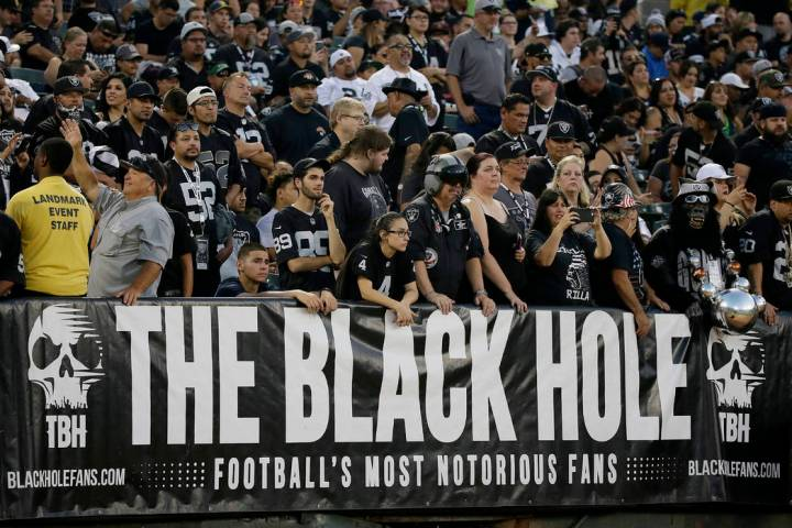 """The Raiders fans comprising The Black Hole relish their antagonistic role, calling themselves """" ..."""