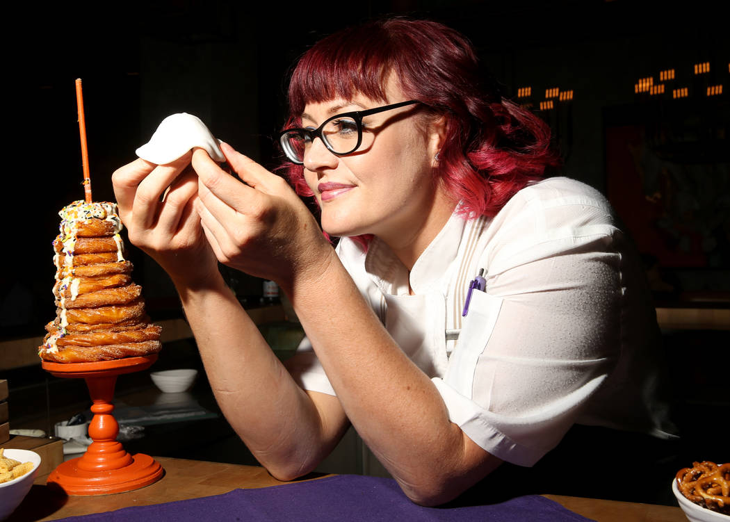 Pastry chef Sara Steele makes a Halloween ghost using fondant over a donut hole at Chica at The ...