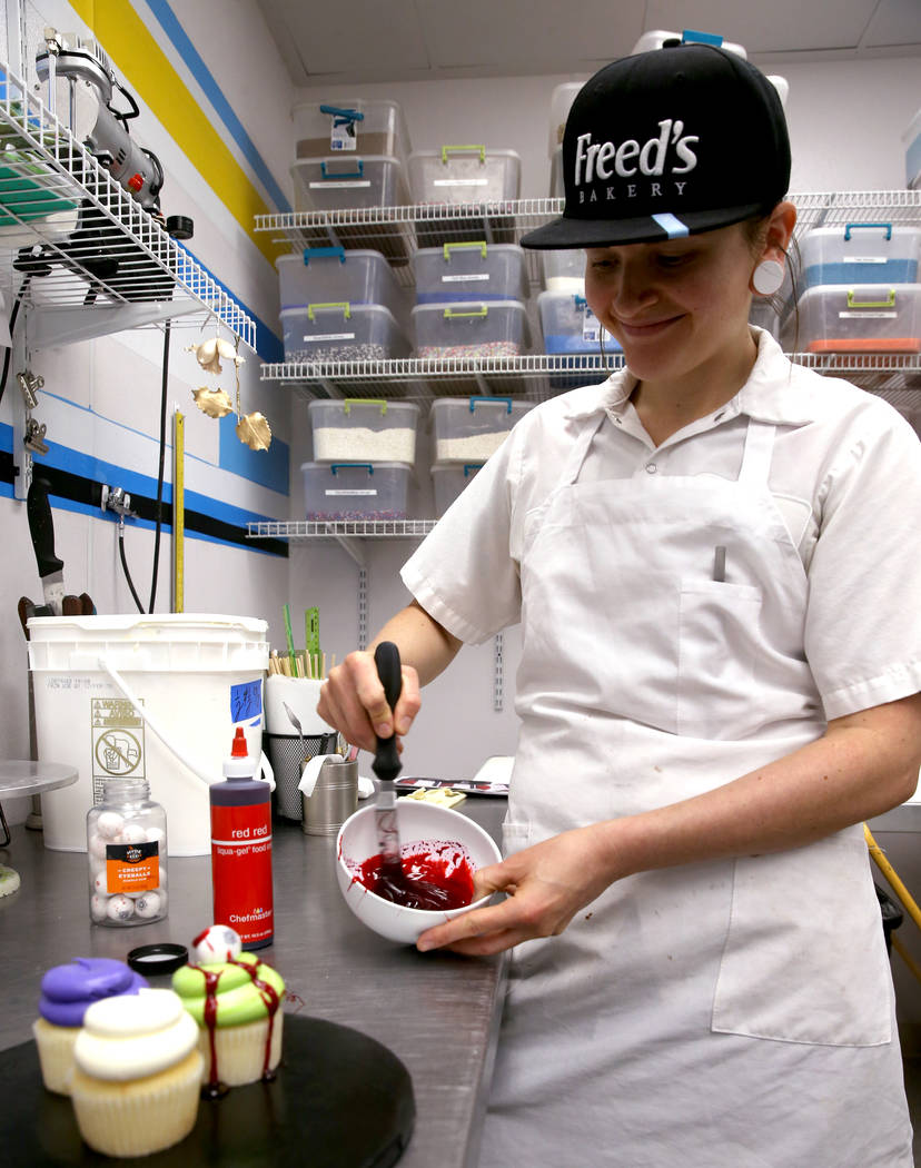 Brittnee Klinger, a cake decorator at Freed's Bakery in Las Vegas shows how to make edible bloo ...