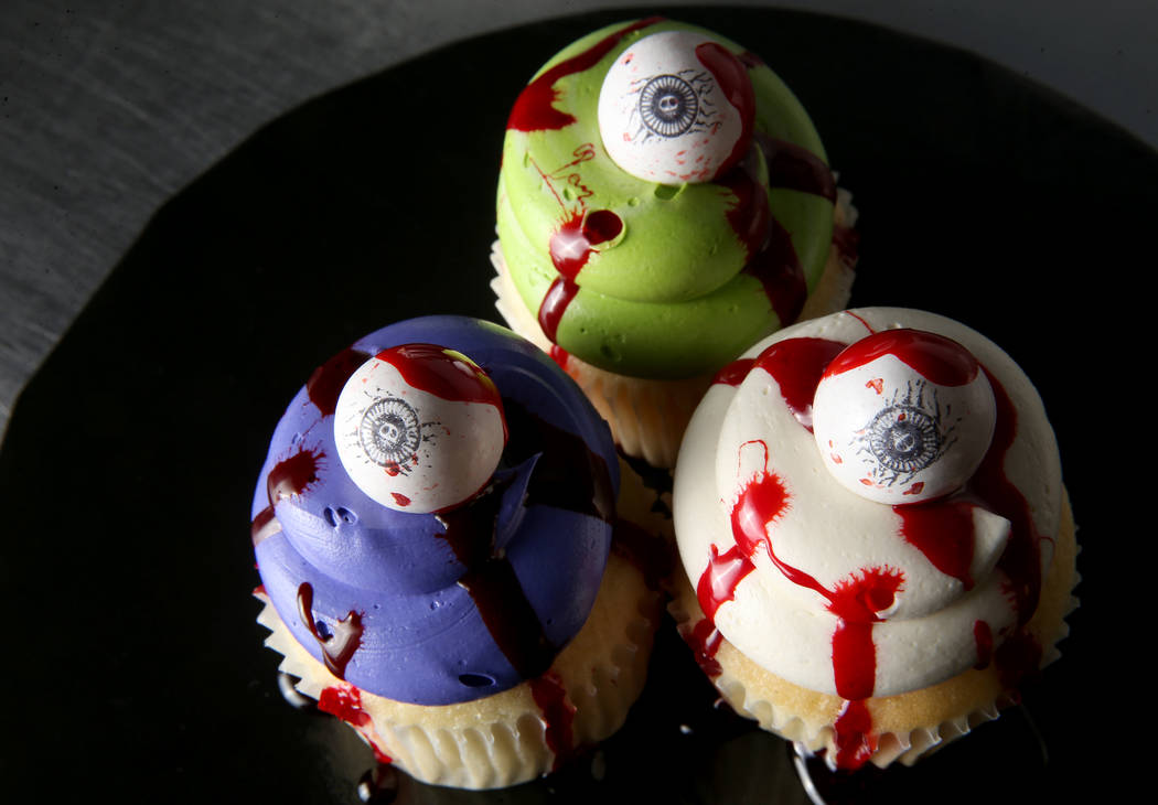 Cupcakes covered in fake blood made with corn starch and red food dye by Brittnee Klinger, a ca ...