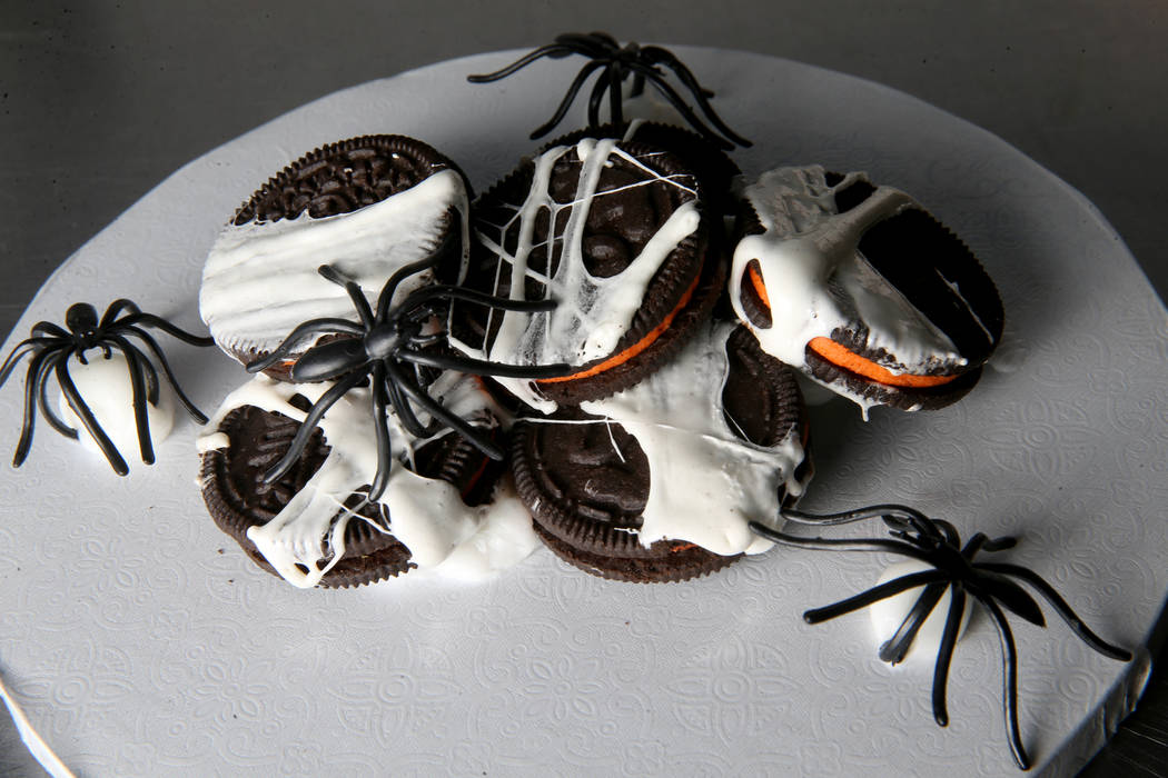 Cookies wrapped in a sweet marshmallow spider web.