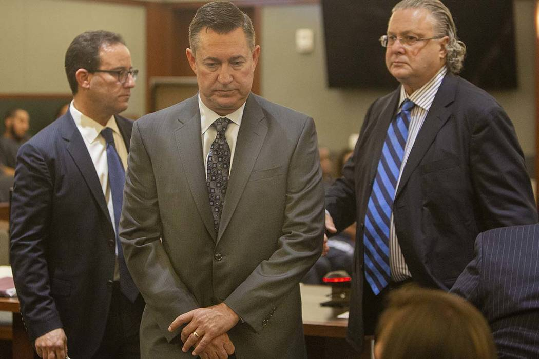Scott Gragson, center, walks out of court with his attorneys, Richard Schonfeld, left, and Davi ...