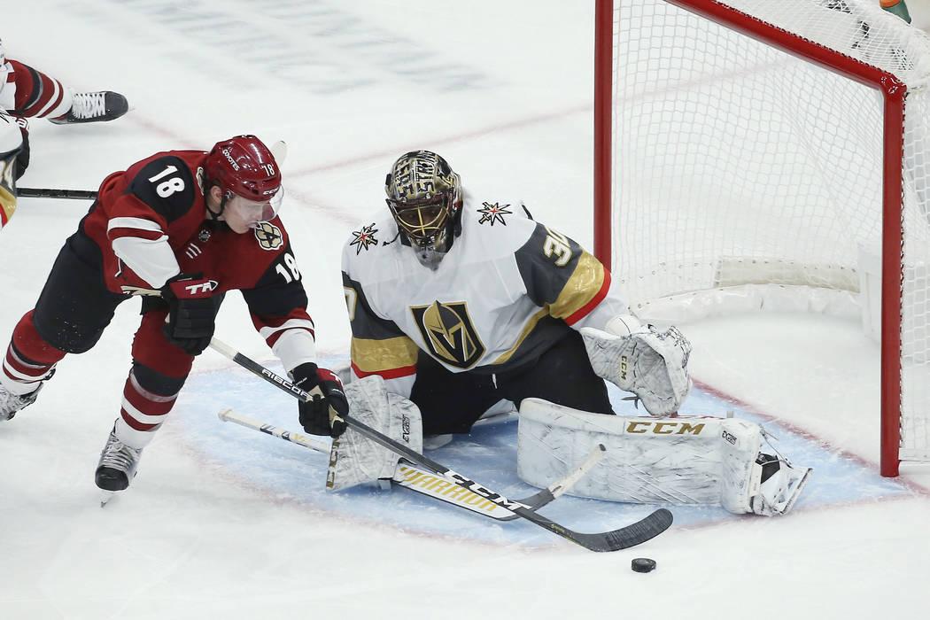 Arizona Coyotes left wing Christian Dvorak (18) has his shot blocked by Vegas Golden Knights go ...