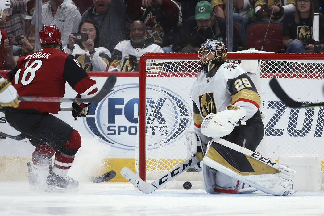 Vegas Golden Knights goaltender Marc-Andre Fleury (29) gives up a goal to Arizona Coyotes' Cono ...