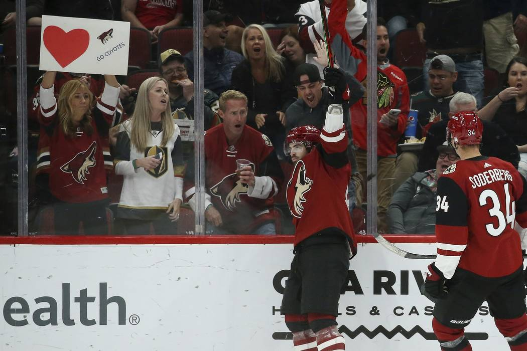 Arizona Coyotes right wing Conor Garland, left, celebrates his goal against the Vegas Golden Kn ...