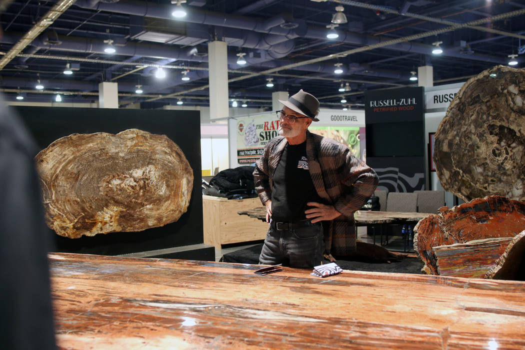Ralph Thompson of Massachusetts, owner of Russell-Zuhl Petrified Wood, stands in front of a pe ...