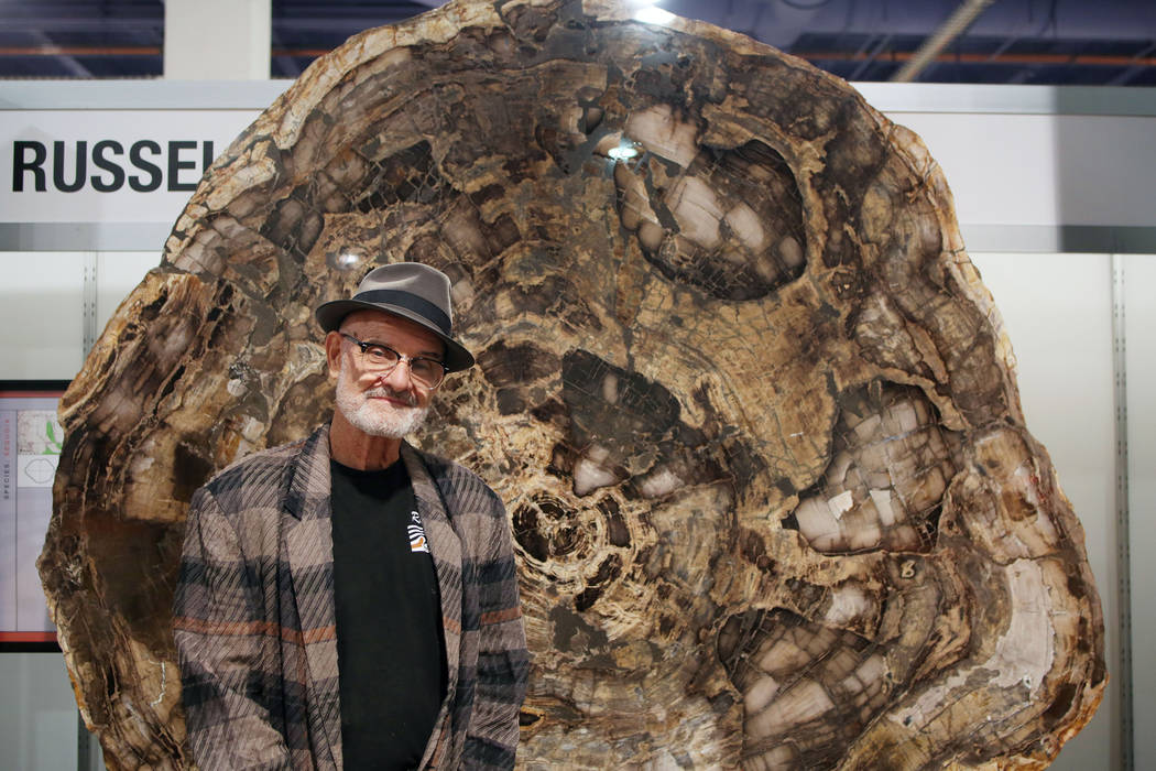 Ralph Thompson of Massachusetts, owner of Russell-Zuhl Petrified Wood, stands in front of a pet ...