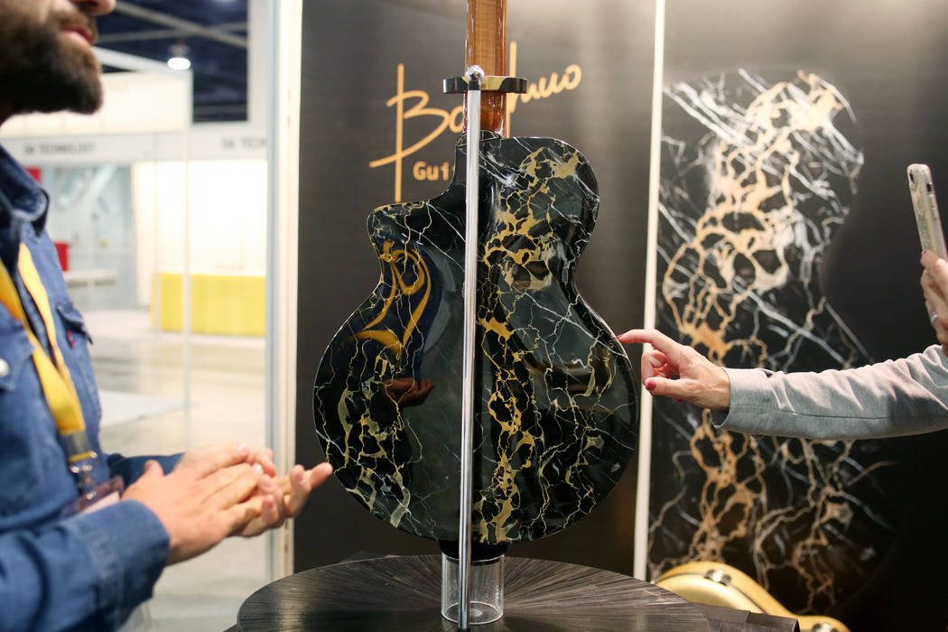 Mirko Borghino's one of a kind luxury handmade guitar made with marble of Italy, displayed for ...